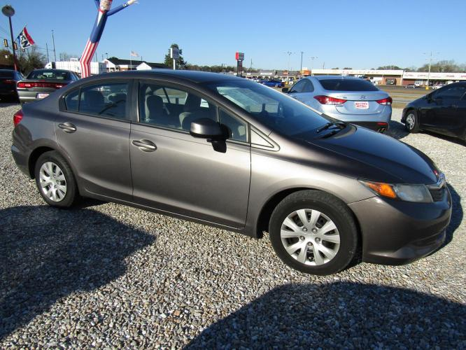 2012 Brown /Tan Honda Civic LX Sedan 5-Speed AT (19XFB2F58CE) with an 1.8L L4 SOHC 16V engine, Automatic transmission, located at 15016 S Hwy 231, Midland City, AL, 36350, (334) 983-3001, 31.306210, -85.495277 - Photo #0